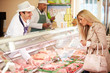 Butcher Serving Customer In Shop - 60151949