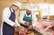 Butcher Teaching Apprentice How To Prepare Meat