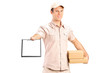 Delivery boy holding a packet and giving a clipboard for signatu