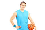 Male basketball player holding a ball