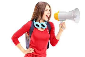 Female student shouting via megaphone
