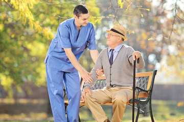 Healthcare professional talking with senior man outside