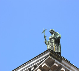 Statue of a preacher on the roof of St. Isaac's Cathedral in St.