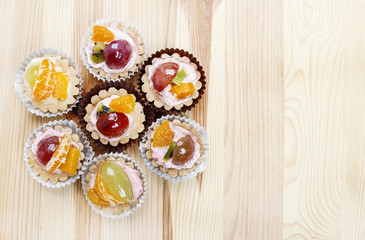 Top view on flower shape group of cupcakes - I love sweets idea.
