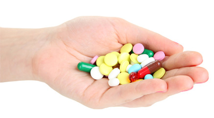 Pills in hand isolated on white