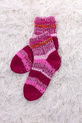 Woolen socks, on color background