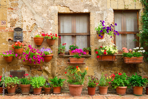 Beautiful street decorated with flowers in Italy|60154581