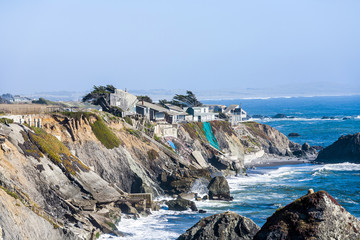 wooden houses at wild pacific coast