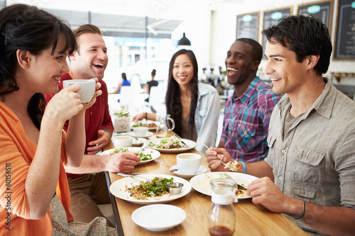 Group Of Friends Meeting For Lunch In Coffee Shop - 60156511