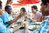 Group Of Friends Enjoying Meal At Outdoor Restaurant - Fine Art prints
