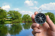 Man navigating the countryside with a compass