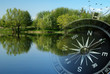Magnetic compass over a tranquil lake