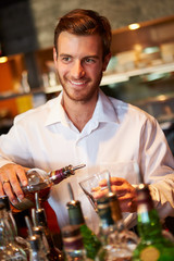 Barman Serving Drinks In Nightclub