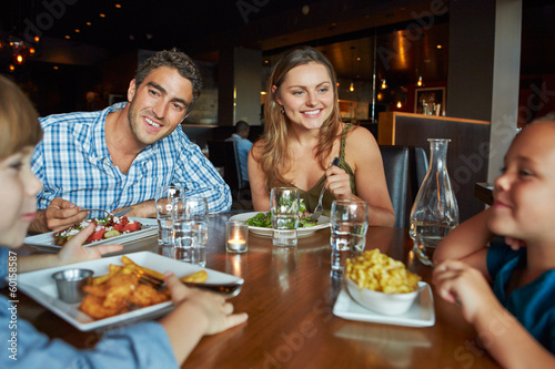 Family Enjoying Meal In Restaurant