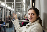 Female passenger in subway train