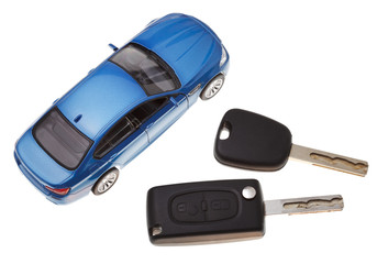 top view of two vehicle keys and model car