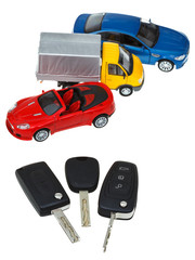 three vehicle keys and model cars