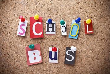 """Message """"SCHOOL BUS""""on cork board."""