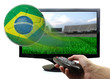 Soccer ball with Brazil flag flying off screen isolated