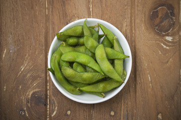 Edamame soy beans in white plate