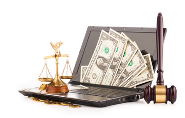 laptop computer keyboard  money and gavel