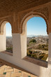Arches of Generalife palace in Alhambra with garden view