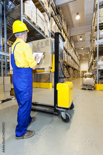 Worker checking products in warehouse