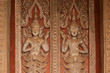 Ancient Laos art wood carving in Laos temple.
