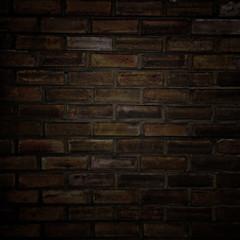 dunkle Ziegelmauer mit Vignette.