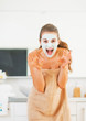 Young woman with cosmetic mask on face scaring
