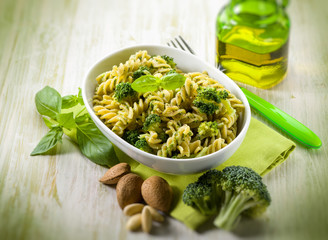 fusilli with broccoli and almond sauce, selective focus