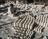 India, Jaipur, indian man working in a ceramics factory