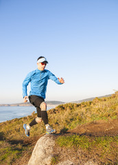 Man practicing trail running outdoors