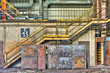 Yellow industrial staircase into an abandoned factory