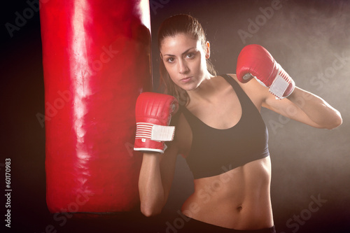 Female athlete with a punching bag