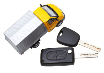 top view of two vehicle keys and truck model