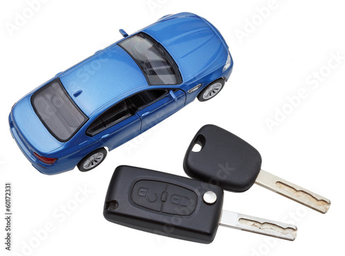 above view of two vehicle keys and model car