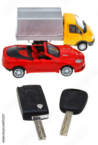 two vehicle keys and model truck and car
