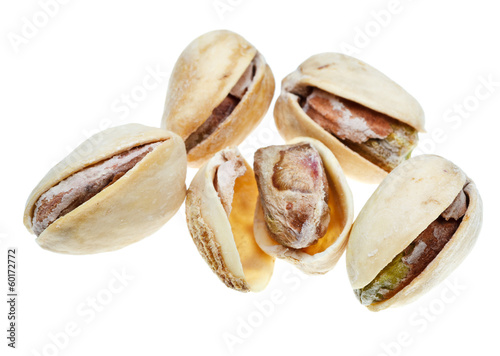 several salted pistachio nuts close up