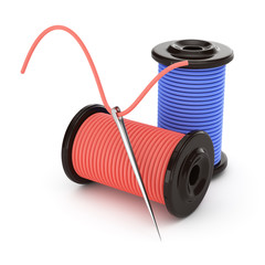 needle and spools of thread