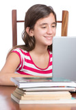 Teenager doing homework or browsing the web on her laptop
