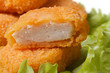 Fresh Chicken Nuggets on a green lettuce close up. macro