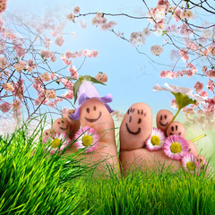 Happy together: Feet on summer meadow