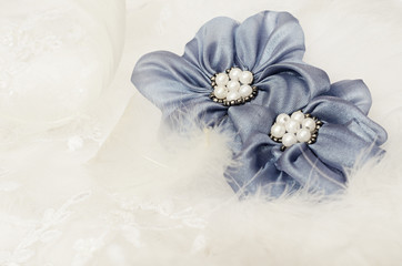 Blue flowers on white lace