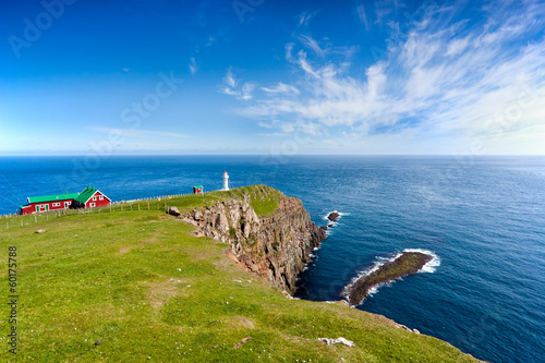 Lighthouse on a rocky promontory