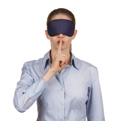Young woman blindfolded calls for silence