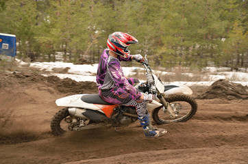 MX racer leaves the deep sandy ruts