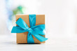 Gift box with blue ribbon - 60179725