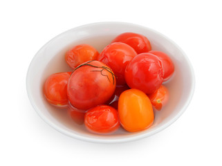 Marinaded tomatoes in a white plate.