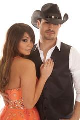 Woman orange dress hand on cowboy